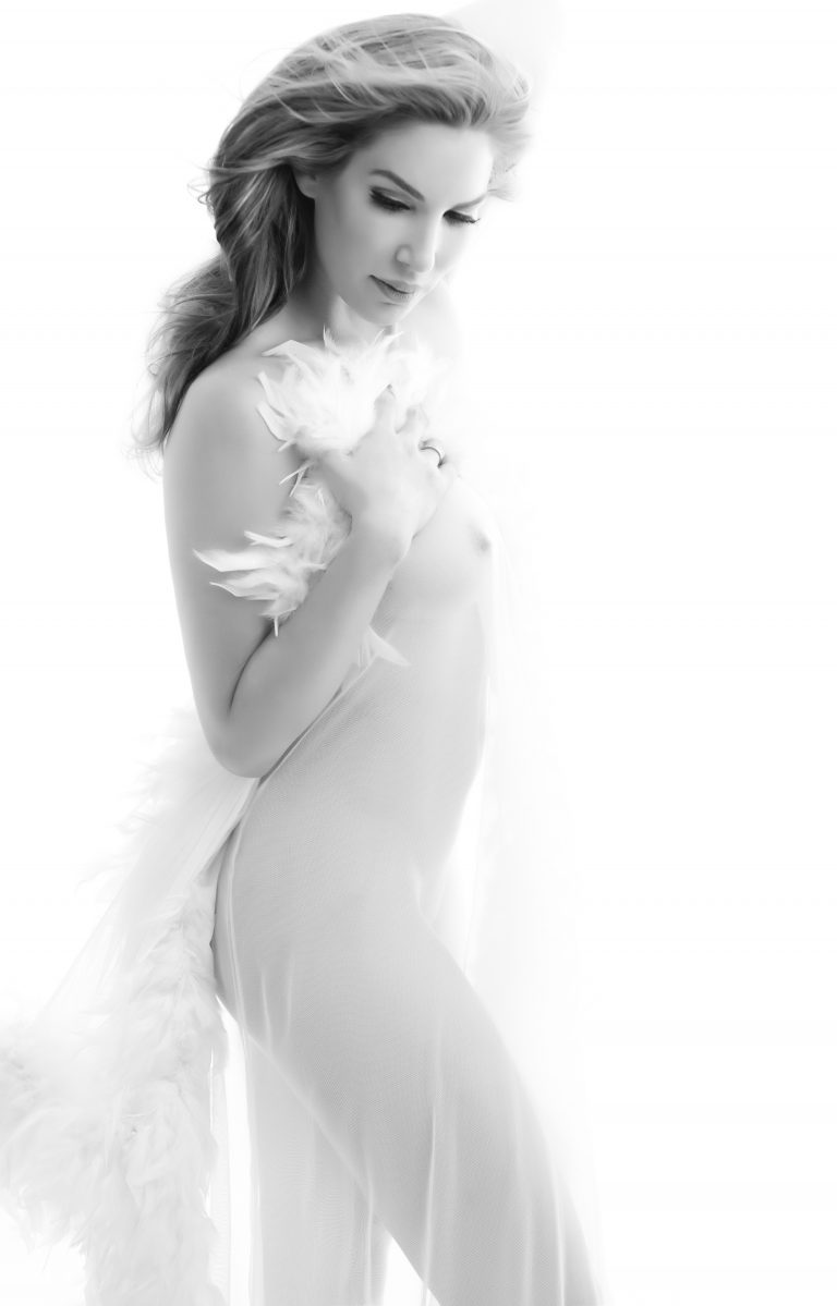 artistic-nude-boudoir-photos-woman-white-feathers-fabric-juliati-photography